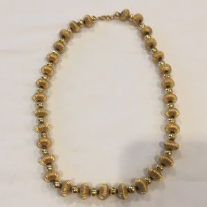Gold colored, metal beaded necklace. 16 inches